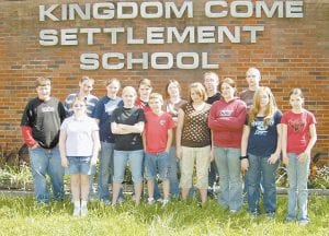 CLOSING SOON -  Eighth-grade students who will graduate from the Kingdom Come Settlement School on May 23 gathered for a photograph last week with friends from the sixth and seventh grades. Pictured front row, left to right, are Alex Cornett (7th grade), Megan Cole (7th grade), Adam Cornett (6th grade), Shumaya Cook (8th grade), Whitney Hall (8th grade), Ashton Turner (8th grade) and Wendy Smith (8th grade). Back row, Cody Fields (8th grade), A.J. Slone (8th grade), Brandy Porter (7th grade), Rachel Sexton (6th grade), Ashley Frazier (8th grade), Tyler Hammonds (8th grade) and Tyler Herron (8th grade).