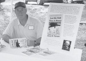 BOOK SIGNING SET -  Author Gary Varner is pictured at a recent book signing. He will be autographing his book Let Me Tell  You a Story at the Little Shepherd Arts and Crafts Show in Jenkins May 18-20.