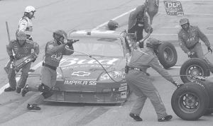 Dale Earnhardt Jr.'s pit crew serviced his car during the NASCAR Nextel Cup Dodge Avenger 500 auto race Sunday at the Darlington Raceway in Darlington, S.C. (AP Photo/Mary Ann Chastain)