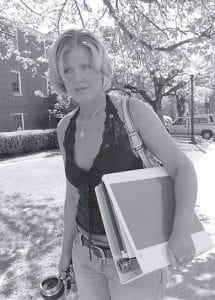 Sara Bailey, daughter of deceased Sago miner George Junior Hamner, walks from a U.S. Department of Labor's Mine Safety and Health (MSHA) briefing last week in Buckhannon, W.Va. carrying the official report of the agency's findings. (AP Photo/Dale Sparks)