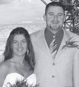 MARRIED -  Malinda Ann Hager, daughter of Mark and Pearl Dickison and William and Amanda Curtsinger, Nicholasville, and Christopher Shawn Breeding, son of Donny Breeding and Walena Breeding, Lexington, were married in a sunset ceremony October 20 at Hyatt Regency Beach Resort on the island of Aruba. The bridegroom is the grandson of Goldie Cornett of Hallie and the late Coy Cornett, and the late Burnette and Lillian Breeding, formerly of Isom. The couple are residing in Lexington.