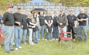 THE LETCHER COUNTY SHERIFF'S DEPARTMENT Team stood in front of a castle members of their team had built for the American Cancer Society's Relay for Life held at River Park in Whitesburg on May 18. Pictured are Mickey Stines, Sheriff Danny Webb, Mike Rose, Destiny Rose, Shae Rose, Malorey Fields, Crystal Davis, LaShawna Frazier, Sameerah Frazier, Tammy Holbrook, Gale Dean Campbell, Eugene Slone and Bert Slone.