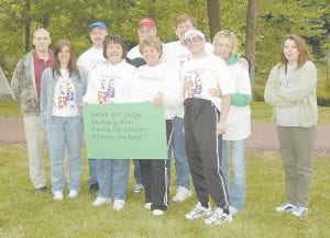 THE LETCHER COUNTY JUDGE'S OFFICE participated in the American Cancer Society's Relay for Life held May 18 at the River Park in Whitesburg. Pictured front row, left to right are Tally Meade, Joan Ward, Hettie Adams, Derek Barto, Ann Adams and Debbie Collins. Back row Codell Gibson, Eddie Meade, Phillip Hampton, and Letcher County Judge/Executive Jim Ward.