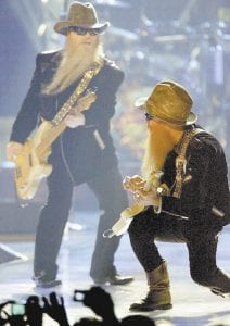 Billy Gibbons, right, and Dusty Hill of ZZ Top are photographed here performing May 12 during the VH1 Rock Honors concert at the Mandalay Bay hotelcasino in Las Vegas. Gibbons and Hill brought their gold guitars with them to eastern Kentucky five days later for a performance in Pikeville. (AP Photo/Isaac Brekken)