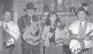 BLUEGRASS BAND -  Mike Havens and Blue Mountain Grass will play June 16 at the Pickin' on the Mountain show at Jenkins. Pictured are (left to right) Mitch Bentley, Mike Havens, Debi Horton, and Mike Wilson. The band is from Mize near West Liberty.
