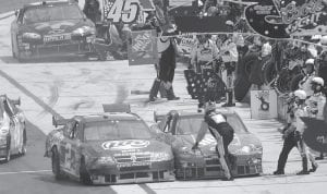 NASCAR driver Kurt Busch (2), left, made contact with NASCAR driver Tony Stewart, right, as Stewart was stopped at his pit stop during the Autism Speaks 400 auto race at the Dover International Speedway in Dover, Del., on Monday. (AP Photo/Carolyn Kaster)