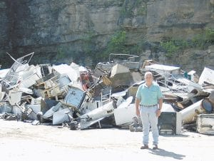 GETTING RID OF OLD APPLIANCES -  Gary Cornett, county recycling coordinator, recently stood in front of a large pile of scrap metal and appliances gathered near the recycling center located at Cowan. He said the recycling center has collected 143 tons of scrap metal and appliances this year.