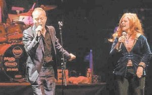 STILL MAKING MUSIC -  Fred Schneider, left, and Kate Pierson of The B-52's. The band returned to Athens, Ga., to record their first album in 15 years. (AP Photo/Jason DeCrow)