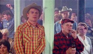 APPEARED IN MOVIE -  Frank Majority Jr., in plaid cap and shirt, shared a pole with actor Tommy Lee Jones in this scene taken from the 1979 movie