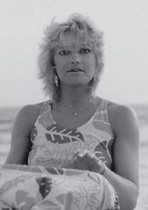 ON THE BEACH -  Pictured sitting on a beach is Sue Thorpe's daughter, Theresa.