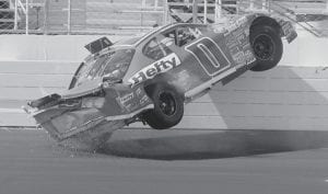 Eric McClure got his Hefty Chevrolet up on the wall in turn 3 during the NASCAR Busch Camping World 200 auto race at New Hampshire International Speedway in Loudon, N.H., on June 30. (AP Photo/Toby Talbot)