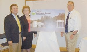 DISCUSSING PLANS -  Dr. Richard Salluzzo, right, president and chief executive officer of Wellmont Health System in Kingsport, visited the Jenkins Library last week to meet with citizens and explain future plans for Jenkins Community Hospital, which Wellmont acquired in May. The hospital's former owner, Gregory Johnson, left, and current administrator Sherrie Newcomb posed with Salluzzo behind an artist's rendering of a renovation project scheduled to begin at the Jenkins hospital soon.