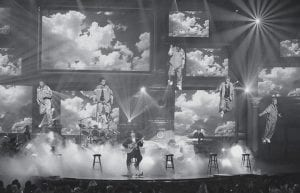 LIST MANIA -  The five members of vocal group 'N Sync were lifted into the air by wires as they performed with guest artist Christopher Cross, seated, during his song