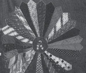 FAMILY HEIRLOOM -  This beautiful quilt made of silk ties was on display at the Gibson family reunion. The quilt was pieced by Louama Gibson Banks. The center was embroidered by Geneva Gibson Caudill and it was quilted by Shirley Sigrest Harris, granddaughter of Beulah Gibson Sigrest Caudill.