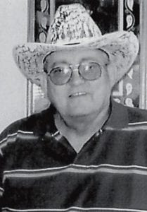 EXPENSIVE HEADWEAR -  Willard Hall is pictured wearing his $5,000 autographed hat.