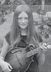 SOLO ARTIST -  Twelve-yearold Cindy Taylor, who plays in the Mountain Melody Band, will make her debut as a solo performer at the Cumberland Mountain Bluegrass Music Festival in Jenkins.