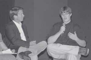 Former Senator John Edwards listened as Machlyn Blair talked about issues facing the region's youth during a forum at Appalshop Theater on July 18. (Photo by Chris Anderson)