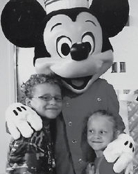 WITH MICKEY MOUSE -  Caleb and Alizah Simpson recently enjoyed a vacation at Disney World in Orlando, Fla. They are pictured with Mickey Mouse.
