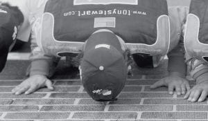 Stewart knelt and kissed the famous brick finish line at Indianapolis Motor Speedway after his win there Sunday. (AP photo)