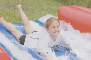 In photo above, McKenzie Gibson hits the slip and slide at the