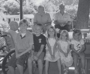 PARTY GOERS -  Enjoying Clyde Hatton's 84th birthday party June 19 were five of Clyde and Oma Hatton's great-grandchildren. Pictured are Beau Hatton, Sam Mullins, Brooke Hatton, Gracie Hatton, and Ellie Beth Mullins. Behind them are Clyde Hatton, Jack Howard and Rob Hatton.
