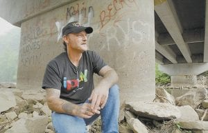 UNDER THE BRIDGE -  Steve Dotson sat recently under the bridge in Gilbert, W.Va., where he lived when he was addicted to prescription painkillers. The Gilbert resident has been clean for over six years. Dotson is one of millions of Americans who has felt the harm that can come with addiction to the prescription narcotic hydrocodone. (AP photo/Jeff Gentner)