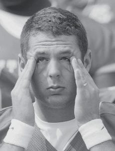 Kentucky receiver Jacob Tamme rubbed his eyes as he awaited more pictures during the team's media day in Lexington on Aug. 3. (AP Photo/Ed Reinke)