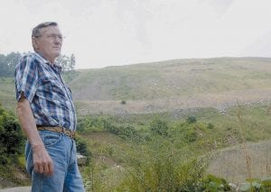 Sam Gilbert looks over a mountain damaged by surface mining near his home in Eolia. The federal surface mining law, which was designed to regulated the environmental impacts of such mining, is now 30 years old. (AP Photo/Samira Jafari)