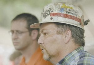 ROOF COLLAPSE -  Doug Johnson, director of corporate services for Murray Energy Corp., and company vice president Rob Moore talked about the six trapped coal miners at the entrance to the Crandall Canyon Mine on Monday, northwest of Huntington, Utah. (AP Photo/Douglas C. Pizac)