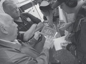 Robert Murray, left, founder and chairman of Murray Energy Corp., showed a thank-you card from one of family members of six trapped coal miners during a news conference Monday at the entrance to the Crandall Canyon Mine in Utah. (AP)