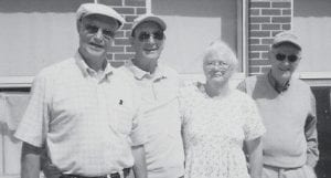 VETERANS -  Pictured with Mary Ann Mullins are World War II veterans (left to right) Ray Shortt, Harold Bryant, and Joe Bukovich.