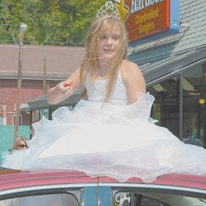McKenzie Gibson of McRoberts rode through Saturday's parade to display a crown she won for being named Little Miss Clintwood (Va.) recently.
