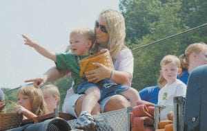 Jesse DePriest and his mother, Hope DePriest, were among a group of riding through Saturday's parade on a fire truck and throwing candy to the parade watchers who were standing along the route.