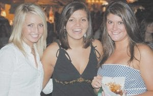 Former Letcher County Central High School basketball stars (from left) Autumn Morris, Whitney Hogg and Cassie Whitaker were all smiles as they enjoyed the festival Saturday night.