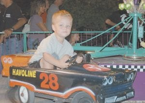 While NASCAR driver Carl Edwards was busy winning a Nextel Cup race in nearby Bristol, Tenn., on Saturday night young Seth McCall was having fun driving this racer on an amusement ride on the midway at the Jenkins Homecoming Festival.