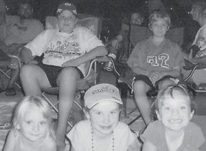 AT THE RACES -  Watching the car transporter parade at Bristol Motor Speedway recently were (first row) Brooke Hatton, Makeena Adkins, Gracie Hatton, (middle row) Hayden Adkins, and Beau Hatton. Also present were Roe Adkins, Sara Hatton, Kendra Adkins, and Cathy Rose. The Adkins family are former Whitesburg residents who now live near Spartanburg, S.C. (Photo by Chris Hatton)