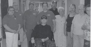 VISITORS -  Clyde Hatton (seated) is surrounded by friends from the Ermine Senior Citizens Center who visited him recently at the Veterans Center in Hazard.