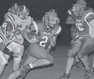 Jenkins quarterback Chris Puckett rushed for a first down during his teams's double-overtime loss. (Photo by Chris Anderson)