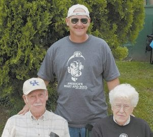Hall posed with parents Bruce and Geraldine Hall during the 2006 Neon Days Festival.