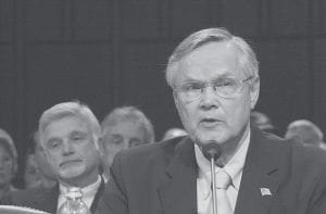 Assistant Labor Secretary for Mine Safety Richard Stickler testified on Capitol Hill in Washington last week before a Senate Appropriations subcommittee hearing on the Utah coal mine disaster. At left is United Mine Workers of America President Cecil Roberts. (AP Photo/Dennis Cook)