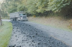 SPILLED LOAD -  An 18-wheel coal truck carefully made its way around a load of coal that was spilled onto Thornton Road (KY 1862) on September 13 when another 18-wheeler lost the tonnage after its tailgate came open. (Eagle photo)