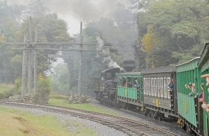A passenger train from the Cass Scenic Railroad pulled into the Whittaker station on Sept. 14. The railroad draws 40,000-70,000 tourists between May and October, opting for the five-hour journey to Bald Knob, West Virginia's third-highest peak. (AP Photo/Jeff Gentner)