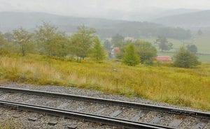 Railroad tracks run near a farm on the Cass Scenic Railroad. (AP Photo/Jeff Gentner)
