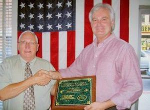 RECEIVES AWARD -  Jenkins Independent Schools Superintendent John Shook, left, was honored by the Kentucky Valley Educational Cooperative for his outstanding contribution as chairman. Presenting the honor was Jeff Hawkins.