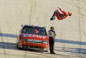 FLIPPED OVER WIN -  NASCAR driver Carl Edwards back flipped off his car as he celebrated winning the NASCAR Dodge Dealers 400 auto race at Dover International Speedway in Dover, Del., on Sunday. (AP Photo/Carolyn Kaster)