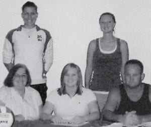 VOLLEYBALL PLAYER -  Jodi Combs (seated, center), a 2007 graduate of Letcher County Central High School, is a freshman at the University of the Cumberlands in Williamsburg. She is a member of the UC Lady Patriots volleyball team, where her positions are setter and defensive specialist. She is pictured with her parents, James and Vonda Combs of Linefork (seated).