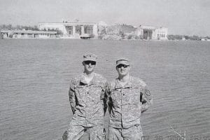 BROTHERS HOME FROM WAR -  SPC Kelly Sexton and SPC Mikey Combs of Little Dry Fork were stationed 16 miles apart in Baghdad in Iraq, where this photo was made last month. Their father, James Sexton, said the two talk little about some of the terrible things they saw during their tours of duty. James Sexton says he's glad his sons are home from what he considers a