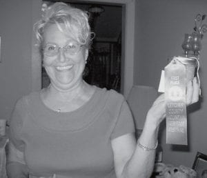 BLUE RIBBON WINNER -  Deborah Miranda of Thornton, won a blue ribbon in the Mountain Heritage Festival canning contest for the yellow tomatoes she grew and canned.