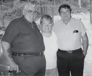 FAMILY REUNION -  Astor Halcomb and Gale Ison of Cumberland are pictured at the Halcomb family reunion with their aunt. The two men are cousins of Whitesburg correspondent Oma Hatton.