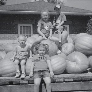 AT THE PUMPKIN PATCH -  Visiting The Pumpkin Patch in Georgetown recently were Creed Warf (top), Nora Hall, Lily Anderson, and Amelia Hall (seated). They are the grandchildren of Terry and Pam Anderson of Whitesburg, Sam and Karen Hall of Somerset, Fred and Sue Webb of Mayking, and Bobby and Terry Warf of Payne Gap.